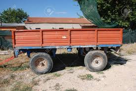 An Old Red Trailer Used On A Farm Stock Photo