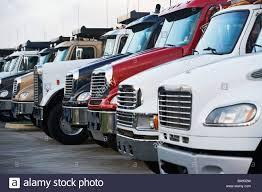 Semi Trucks In A Row Stock Photo, Royalty Free Image: 23554577 - Alamy Electric Semi Trucks News Videos Reviews And Gossip Jalopnik Of Tesla Semi Leads Analyst To Downgrade Major Truck Stocks Trucks For Sale Harmon Transit Llc Semitruck Trends 2017 Fleet Clean Global Food Distributor Will Add 50 Its Fleet Midamerica Truck Show 2014 Custom Youtube Advantage Customs Detailing Kips Auto Detail Stock Photo Image Hauler Tnspiration 56602038 Modern Big Rigs Without Trailers Only Tractors On When Semitrucks Become Like Gadgets We Still Have A Job Semitrucks Pdx Car Salespdx Sales