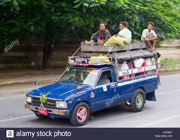 Men Ride On Top Of A Truck In Mandalay, Burma Stock Photo: 60968403 ... The Top 10 Most Expensive Pickup Trucks In The World Drive Want Best Resale Value Buy A Truck Car Pro Tonneau Covers For Ford F150 Customer Picks Truck Covered With Bumper Stickers Carries A Canoe On Top Culver 2 Easy Ways To Draw Pictures Wikihow House On Moving Road Stock Photo Picture And Chip Electronic Circuit Shown Back Of Big Light Bulb Four Things Consider When Choosing Lift Kit Foie Gras Pbj Served From Consuming La Video Pipeline Proster Climbs Gets Arrested 1931 Model At Royers Cafe Round Texas