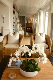 Beach House Living Room With Wicker Chairs And White Slipcover Furniture Is A Chic Coastal Design