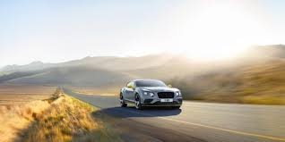 Dark grey Bentley Continental GT Speed Black Edition driving on a country road