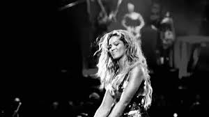 black and white GIF of Beyonce dancing on stage