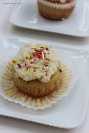 grainfree cupcakes with sprinkles sprinkled coconut frosting vanilla cupcakes