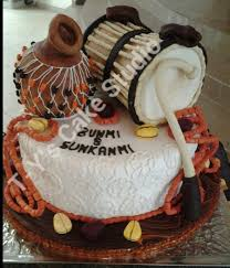 Yoruba traditional wedding cake Talking drum is vanilla coconut cake while base and calabash is fruit cake Every other thing on the cake is gum paste