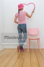 Girl Painting Heart On Wall