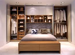 wardrobes on either side of the bed and with long white curtains