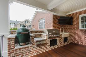 Chic Deep Fat Fryer In Porch Traditional With Brick Facade Next To Outdoor Kitchen Green Egg