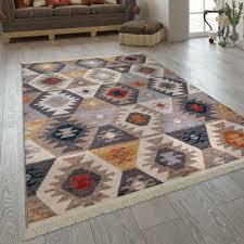 wohnzimmer teppich im ethno design fransen boho stil