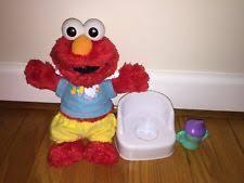 Sesame Street Elmo Adventure Potty Chair Video by Potty Elmo Doll Ebay