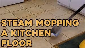 steam mopping a kitchen floor