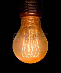 vintage electric yellow light bulb glowing in the stock photo