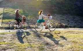 Two Girls Riding A Bike In The Park On Path Sunny Day Friends Leisure