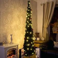 Skinny Christmas Tree Green Lit With Slim Shape Designed Small Lights Combine