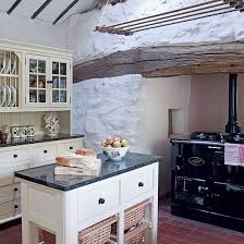 White Traditional Farmhouse Kitchen Small Square Island And Wooden Stained Cabinet Furniture