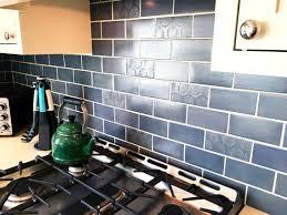blue and copper subway tile kitchen