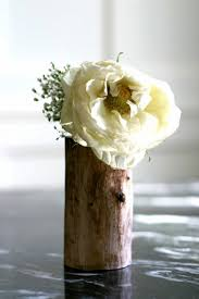 DIY Flower Vase Of A Wood Log Via Shelterness