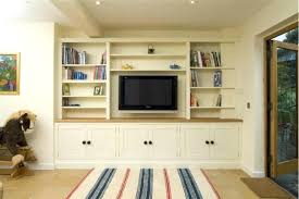 bookcase family finds room behind bookcase family room tv