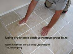 vinegar water removes grout haze and also removes the