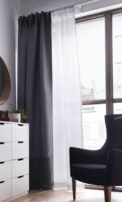 layering a black out curtain with a sheer curtain lets you decide