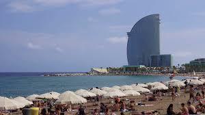 100 W Hotel In Barcelona Spain Bathers On A Mediterranean Beach Crowded Sandy