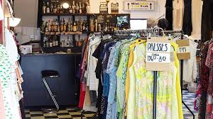 Rails Of Retro Dresses In Front A Bar At Paper Dress Vintage Clothing Shop