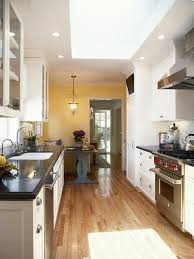 Galley Kitchen With Narrow Island Drinkware Cooktops