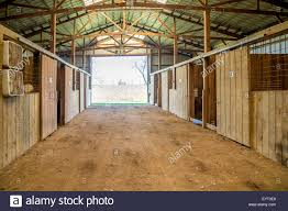 Horse Barn With Stalls In Kentucky USA Stock Photo, Royalty Free ... How Much Does It Cost To Build A Horse Barn Wick Buildings Pole Cstruction Green Hill Savannah Horse Stall By Innovative Equine Systems Redoing The Barn Ideas For Stalls My Forum Priefert Can Customize Your Barns Barrel Racing 10 Acsmore Available With 6 Pond Pipe Fencing Amazing Stalls The Has Large Tack Room Accsories Rwer Rb Budget Interior Ideanot Gate Door Though Shedrow Shed Row Horizon Structures Httpwwwfarmdranchcomproperty5acrehorse