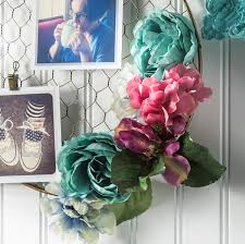Jazz Up A Wire Hanging Photo Holder With Faux Flowers In This Unique DIY Floral Project