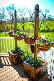 Outdoor Patio Plant Stands by Pallet Planter Stands With Hanging Planter Baskets 30 Diy Pallet