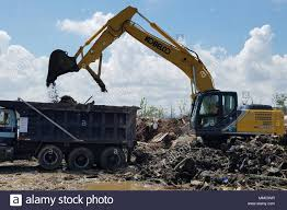 An Excavator Operated By Local Contractors Loads Garbage And Debris ... Public Surplus Auction 1291504 Zilker Thats A Lot Of Dillo Dirt 5 Yards Bulk Pea Gravelst8wg5 The Home Depot Rubbermaid Dump Tilt Truck Black 12 Cubic Yard Fg9t1300bla 2019 New Western Star 4700sf 1618 At Premier Reno Rock Services Page About Rockys Dirts 625 Cubic Yard Tilt Trucks Large Dumping Trash Bins Garick Slts 1 Yards Fill Dirt Lowescom How Does It Measure Up Greely Sand Gravel Inc Dejana 16 Body Utility Equipment