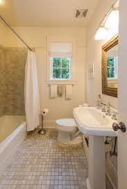 cottage bathroom with tiled wall showerbath high ceiling in