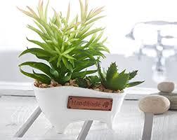 de künstliche kakteen in einer badewanne kaktus