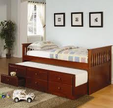 bedroom light brown varnished oak captains bed frame which