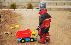A Boy Plays With A Large Toy Truck On The Street Stock Photo ... Large Toy Fire Engines Of The Week Heavy Duty Dump Truck Ride On Imagine Toys Dickie Action Garbage Vehicle Cars Trucks Folk Toy Truck Large Hot Sale 1pc 122 Size Children Simulation Inertia State Cat Big Builder Nordstrom Rack Blockworks Set Save 61 For Toddlers Topqualityeatlarmonsthotwheelsjamgiantgravedigger Amazoncom John Deere 21 Scoop Games 13 Top For Little Tikes