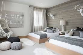 Scandinavian Bedroom With Wooden Accent Wall And Pops Of Gray Design Reed Group