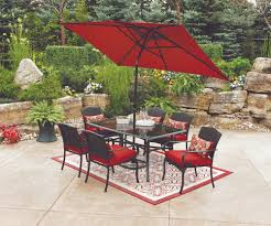 wrought iron outdoor dining chairs with red cushions and red walmart umbrella on cozy outdoor rugs