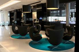 Modern Hotel Lobby Furniture On Round Carpet And Sleek Floor Plus Interesting Lighting