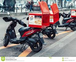Download Pizza Hut Delivery Motorcycle Parked On A Street Editorial Image