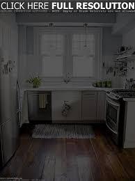 Best Floor For Kitchen 2014 by Impressive White Kitchen Design With Herringbone Floor Tile
