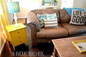 articles with decorative pillows on brown leather couch tag