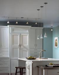 modern white kitchen with pendant and monorail lights kitchen