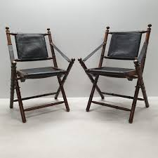 Faux Teak Leather Folding Chairs With Brass Details Winsome Butterfly Folding Chair Frame Covers Target Clanbay Relax Rocking Leather Rubberwood Brown Amazoncom Alexzhyy Mulfunctional Music Vibration Baby Costa Rica High Back Pura Vida Design Set Eighteen Bamboo Style Chairs In Fine Jfk Custom White House Exact Copy Larry Arata Pinated Leather Chair Produced By Arte Sano 1960s Eisenhauer Dyed Foldable Details About Vintage Real Hide Sleeper Seat Lounge Replacement Sets