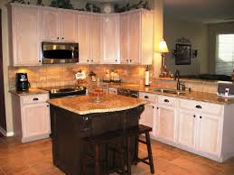 venetian gold granite kitchen backsplash featuring