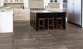 kitchen with brown cabinets and glazed porcelain tiles porcelain
