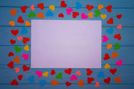 Download White Blank Of Paper With Multicolored Hearts Around On Blue Wooden Background Stock Photo
