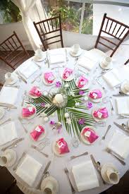 palm leaves on circle table add pineapple center piece plus a