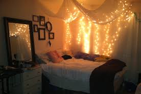 Teenage Girl Bedroom Design With Hanging White Canopy Bed Curtains String Twinkle Lights Over Corner Decoration Plus Wood Bedside Table