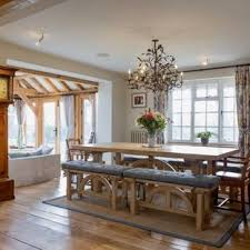 Inspiration For A Farmhouse Dining Room In Hampshire With Beige Walls Medium Hardwood Flooring And