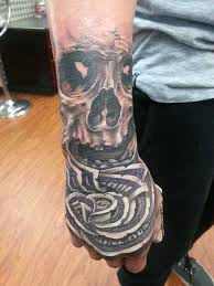 Black And Grey Money Rose With Skull Tattoo On Right Hand