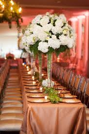 Tall centerpieces with white hydrangea flowers Gold table decor